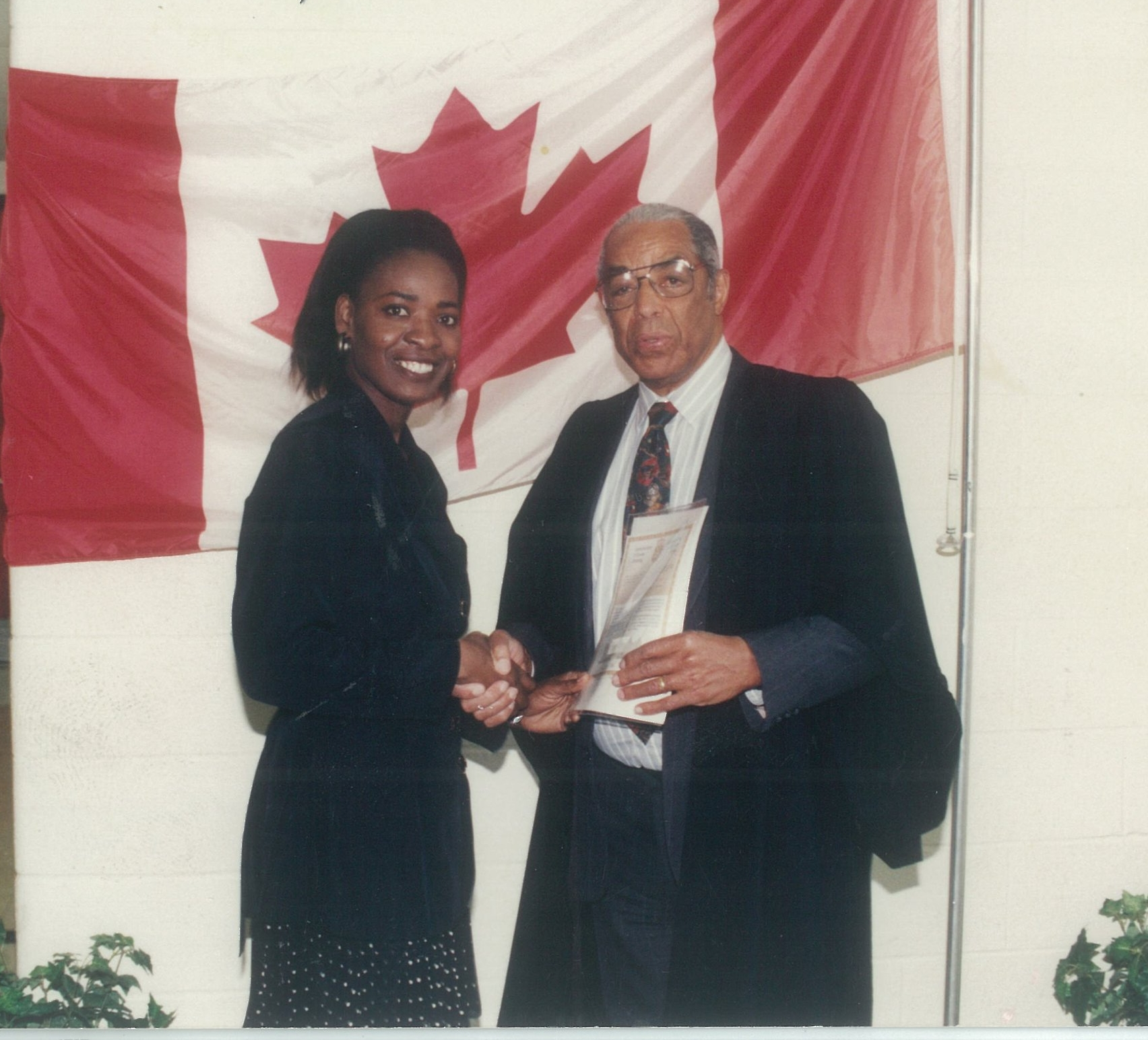 Jamaican Diane Fuller receives her Canadian citizenship from Bromley Armstrong at a special ceremony