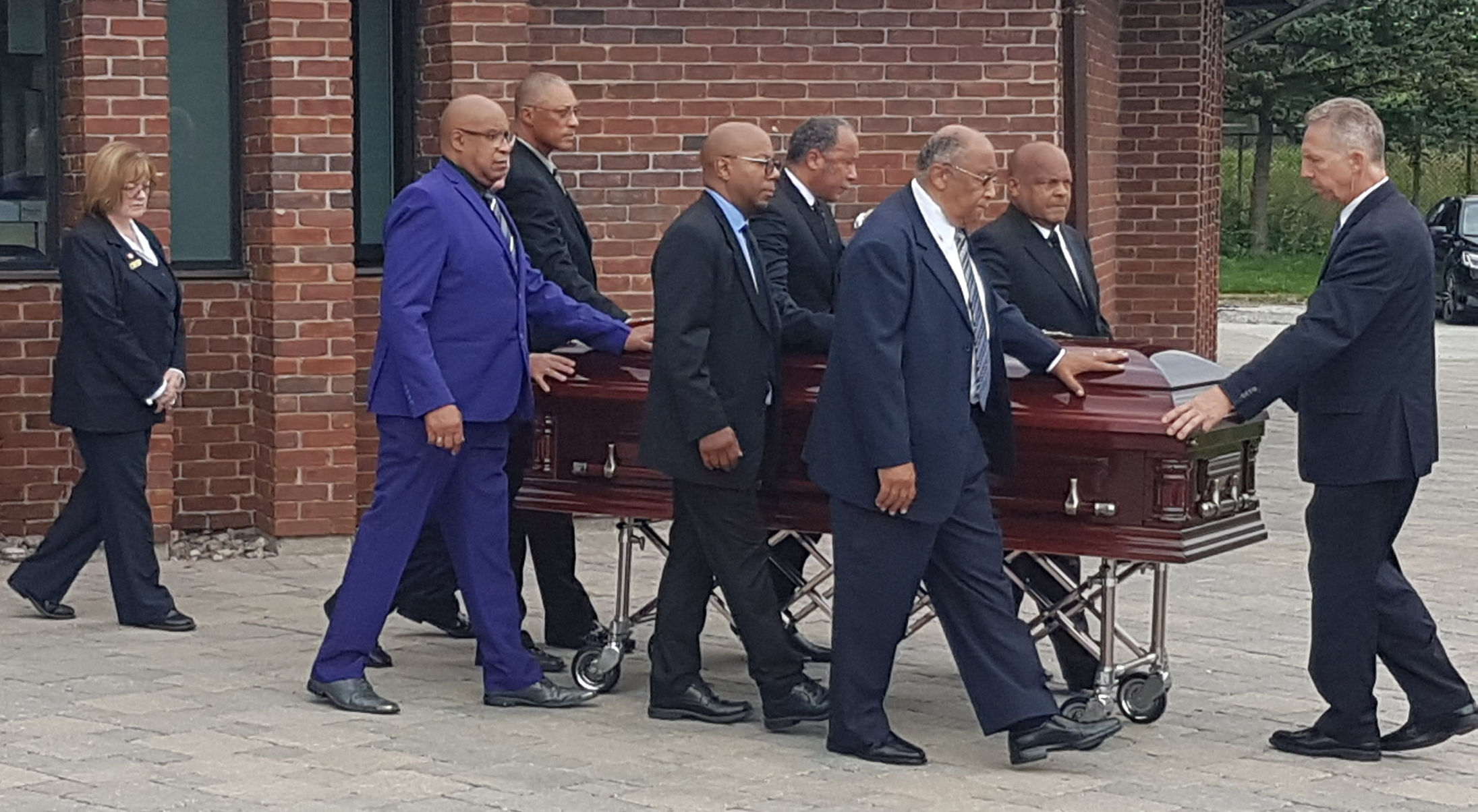 Bromley Armstrong's casket carried from the church