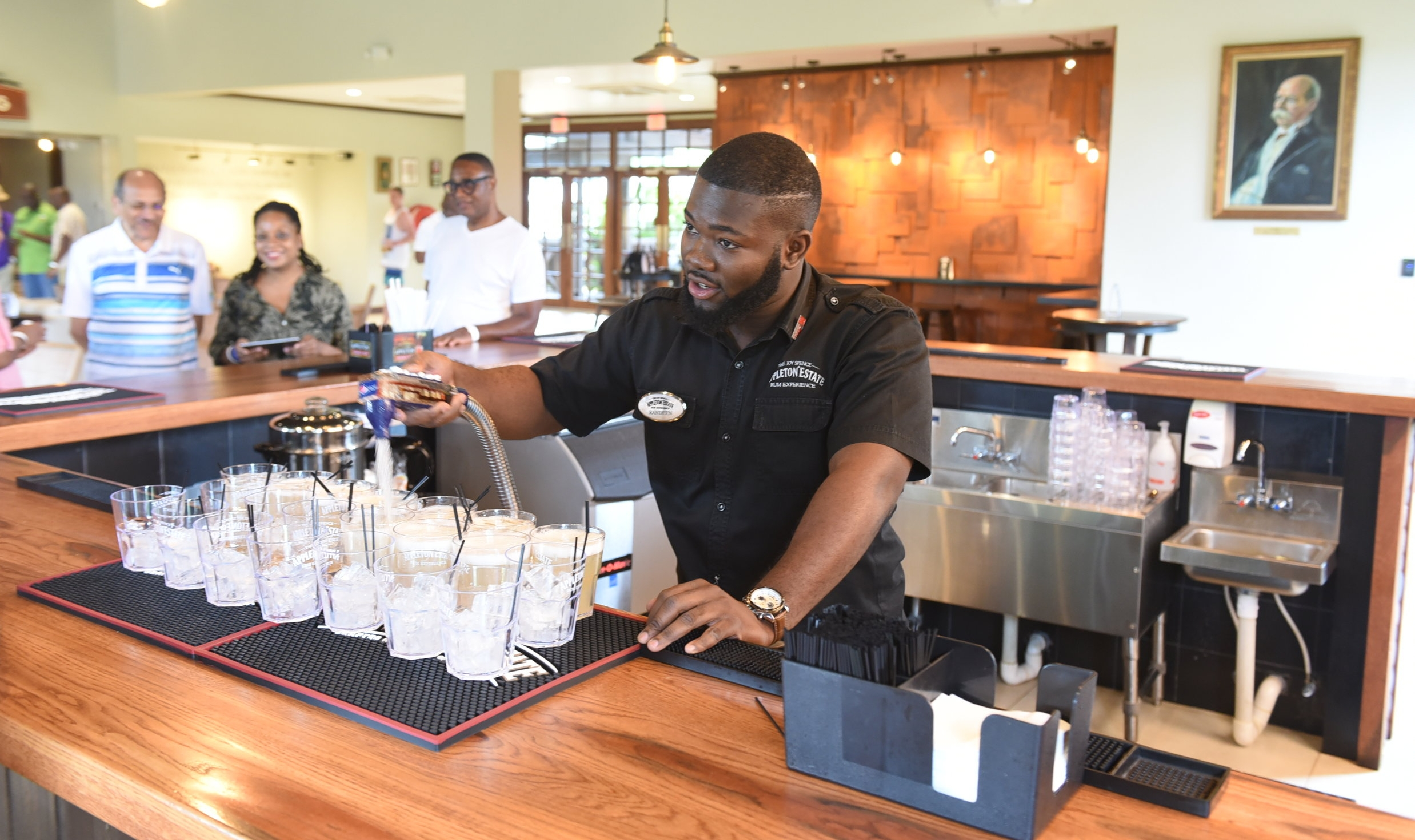 Ramdeen Thomas welcomes visitors with a delightful mixture of Appleton signature blend rum, ginger beer and a splash of Angostura bitters