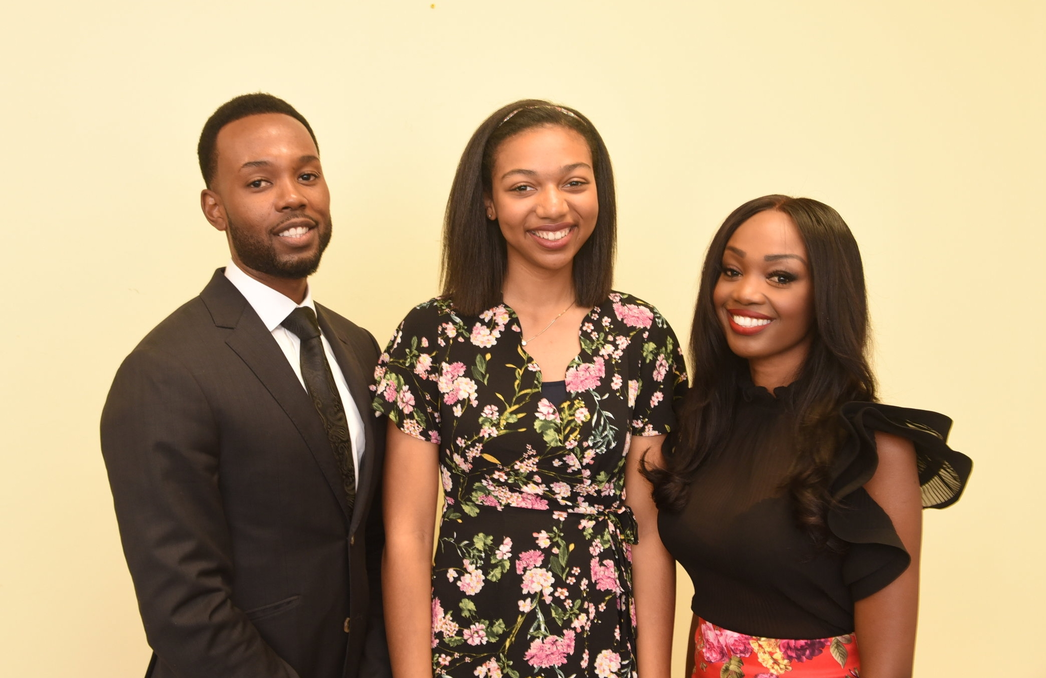 Siblings Kenneth and Stacy-Ann Buchanan (r) presented a scholarship to Kendell Parks