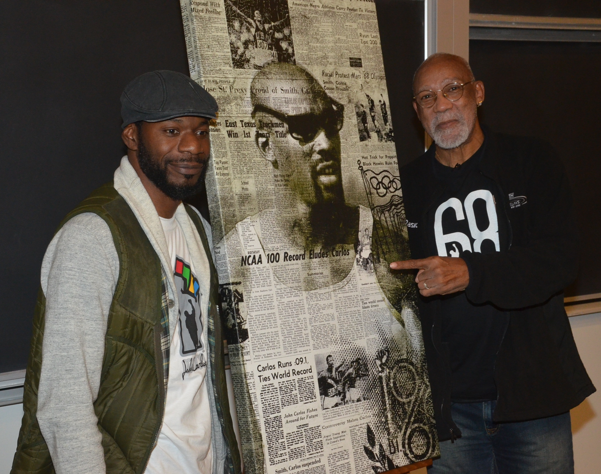 Mark Stoddart (l) presented John Carlos with a personalized painting during his November 2011 visit to Toronto.