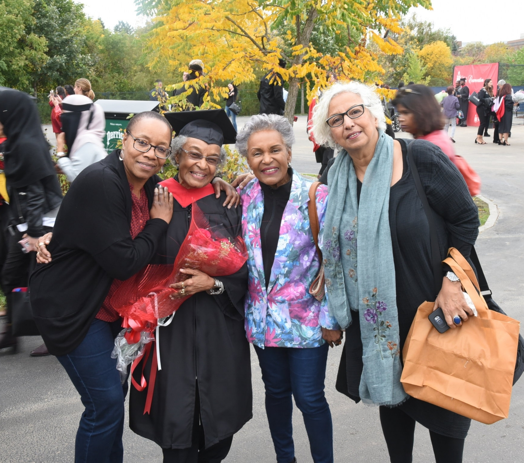 Hortense Anglin joined Celeta Irvin (l) and Nadia Habib (r) in congratulating her older sister Osra Lindo