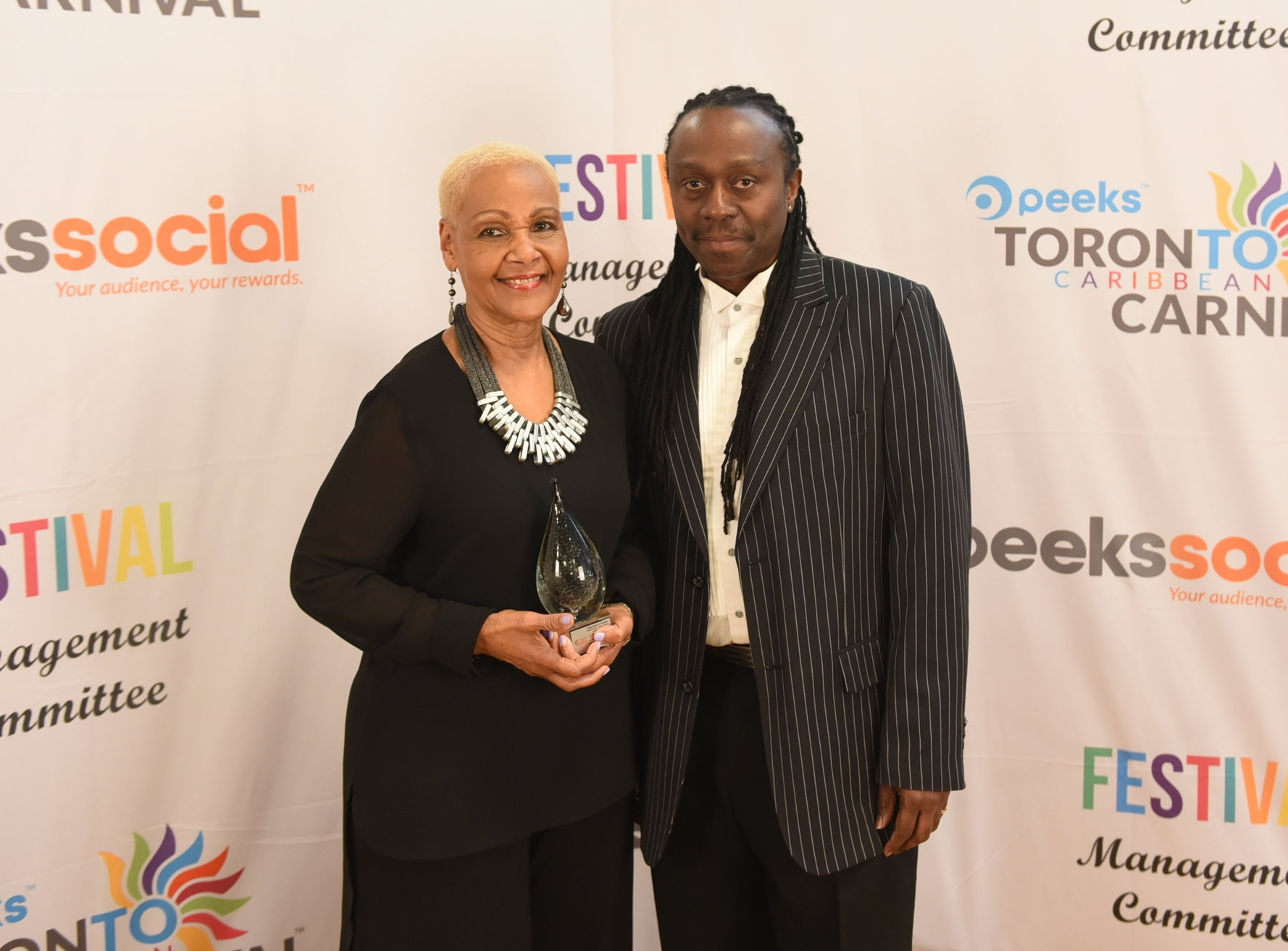 Ossie Gurley presented the Tribute Award to Angela Pierre