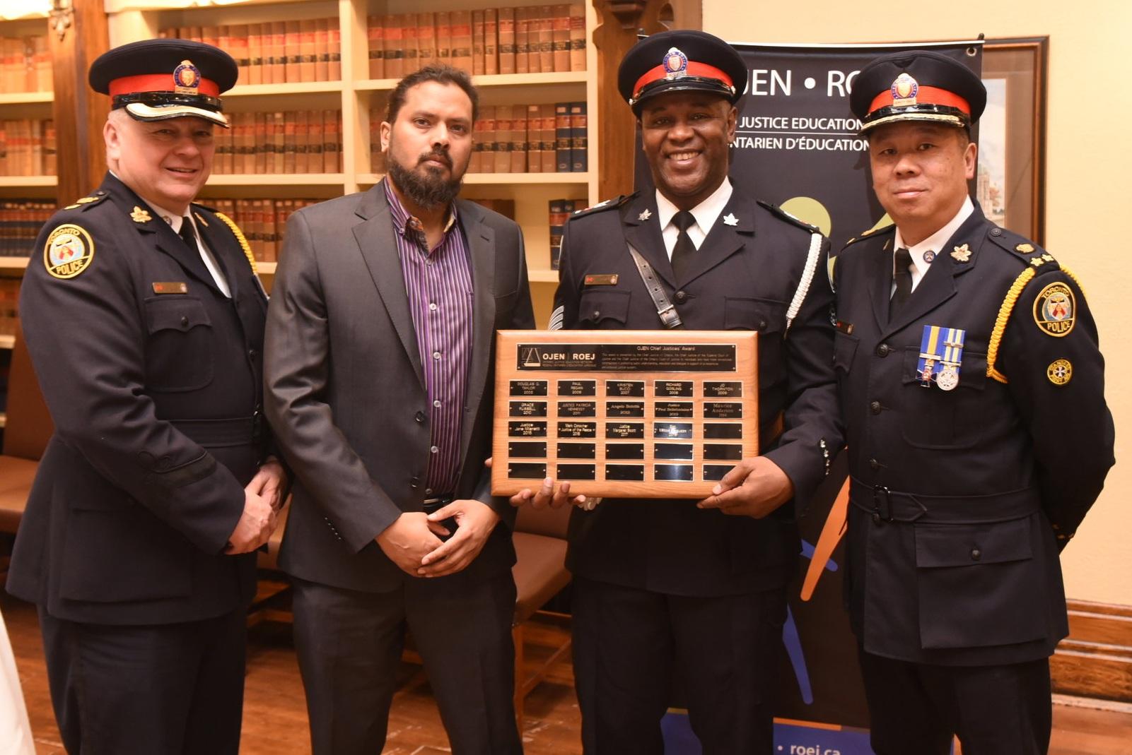 Award winner Sgt. Milton Ferguson with Deputy Chief Peter Yuen (r), Supt. Myron Demkiw & Soul-R-Damon Maraj