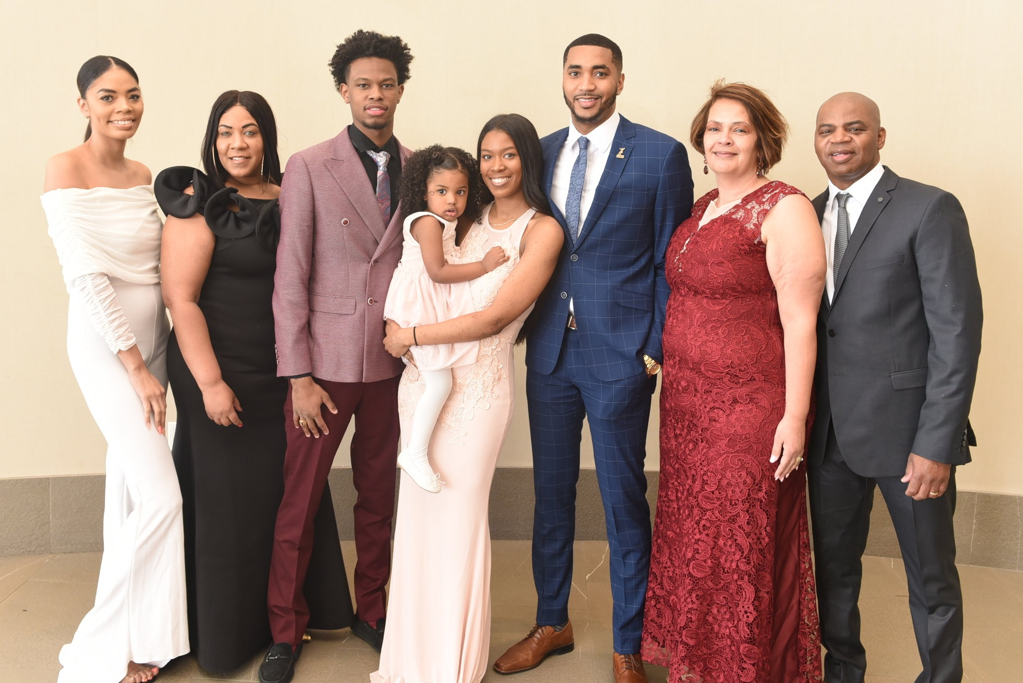 Shaquille Smith and his partner Janessa Tynes with their daughter Zaila surrounded by family members Jasmine Smith (l), Venessa Simmonds and his parents Christine & Gerald Smith