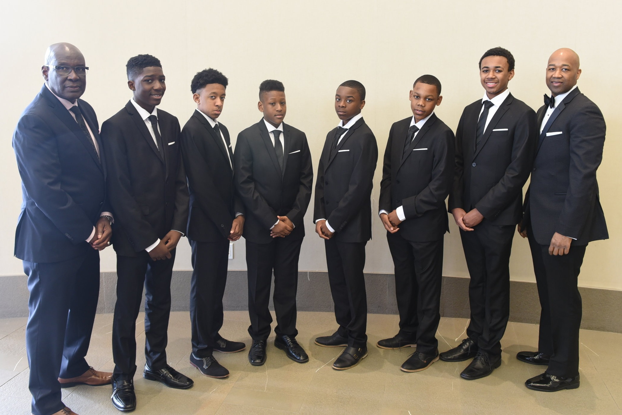 Mickey Hutchinson (l), Director of the Right of Passage Experience Program, and BBPA treasurer Kurt Henry (r) with program participants Ethan Hutchinson, Tajea Henry, Tandre Henry, Cameron Robertson, Reshawn Brown & Nathaniel Peterson. Attending the awards ceremony provided the youths with an opportunity to see what Black excellence looks like.