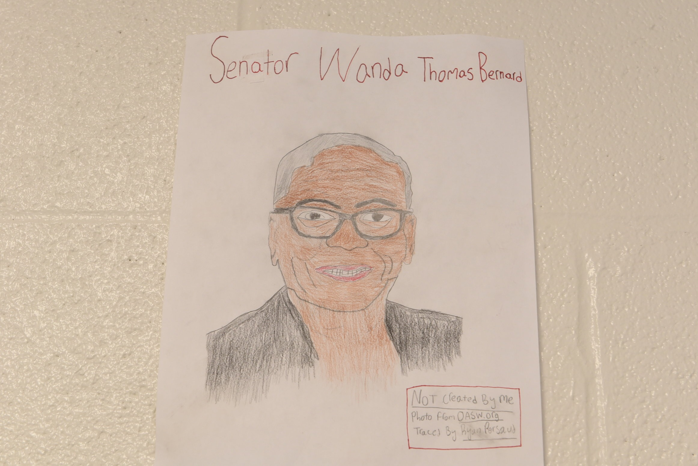A sketch of Senator Wanda Thomas Bernard adorns the new school walls
