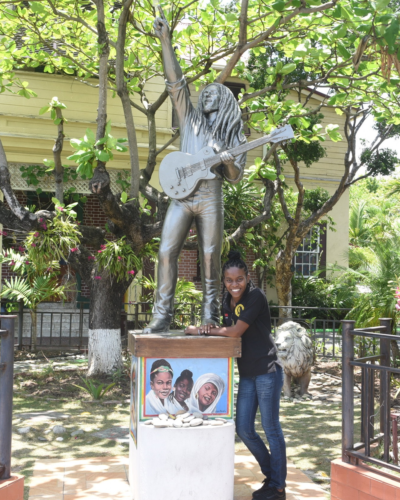 Christain Williams stands proudly next to Bob Marley's statue outside the museum