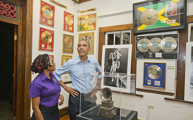 Former US President Barack Obama toured the Museum on his 2015 visit to Jamaica. The tour guide is Natasha Clark…Photo by Reuters/Jonathan Ernst