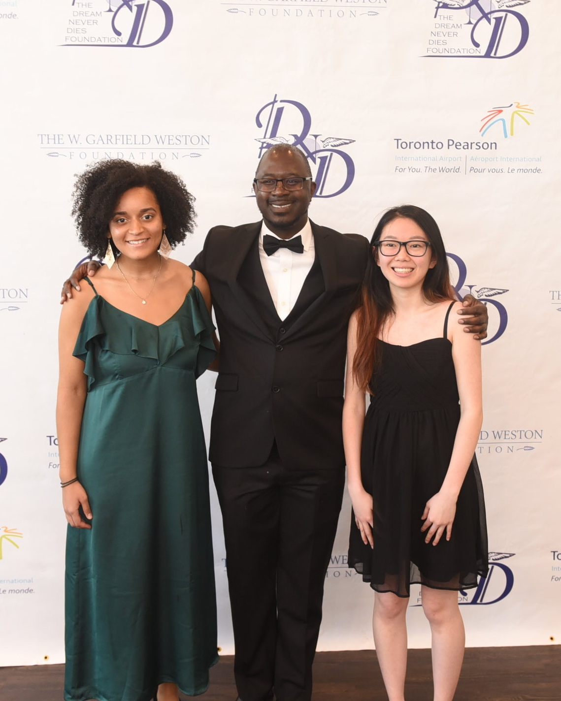 Dr. Ransford Morel-Hyman Jr. presented scholarships to Chantal Phillips (l) & Kristin Wu