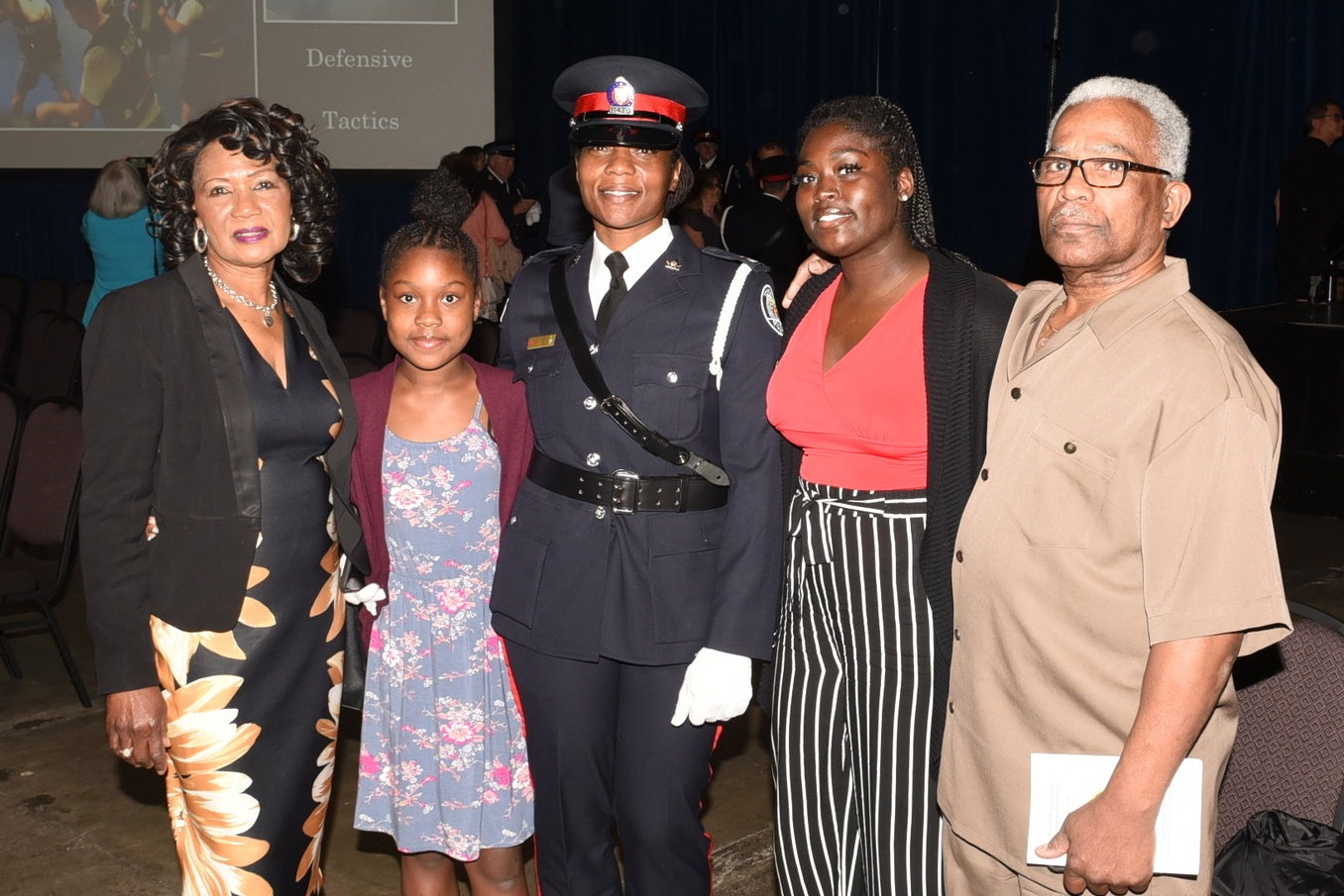 Const. Nathalee Thompson with her parents Delroy Thompson & Eulalee Robinson and children Zakiyyah Williams & Zyanne Thompson