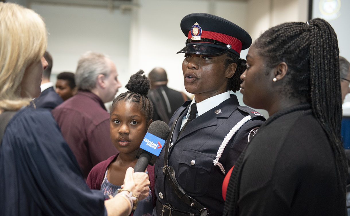 Const. Nathalee Thompson being interviewed after the graduation ceremony