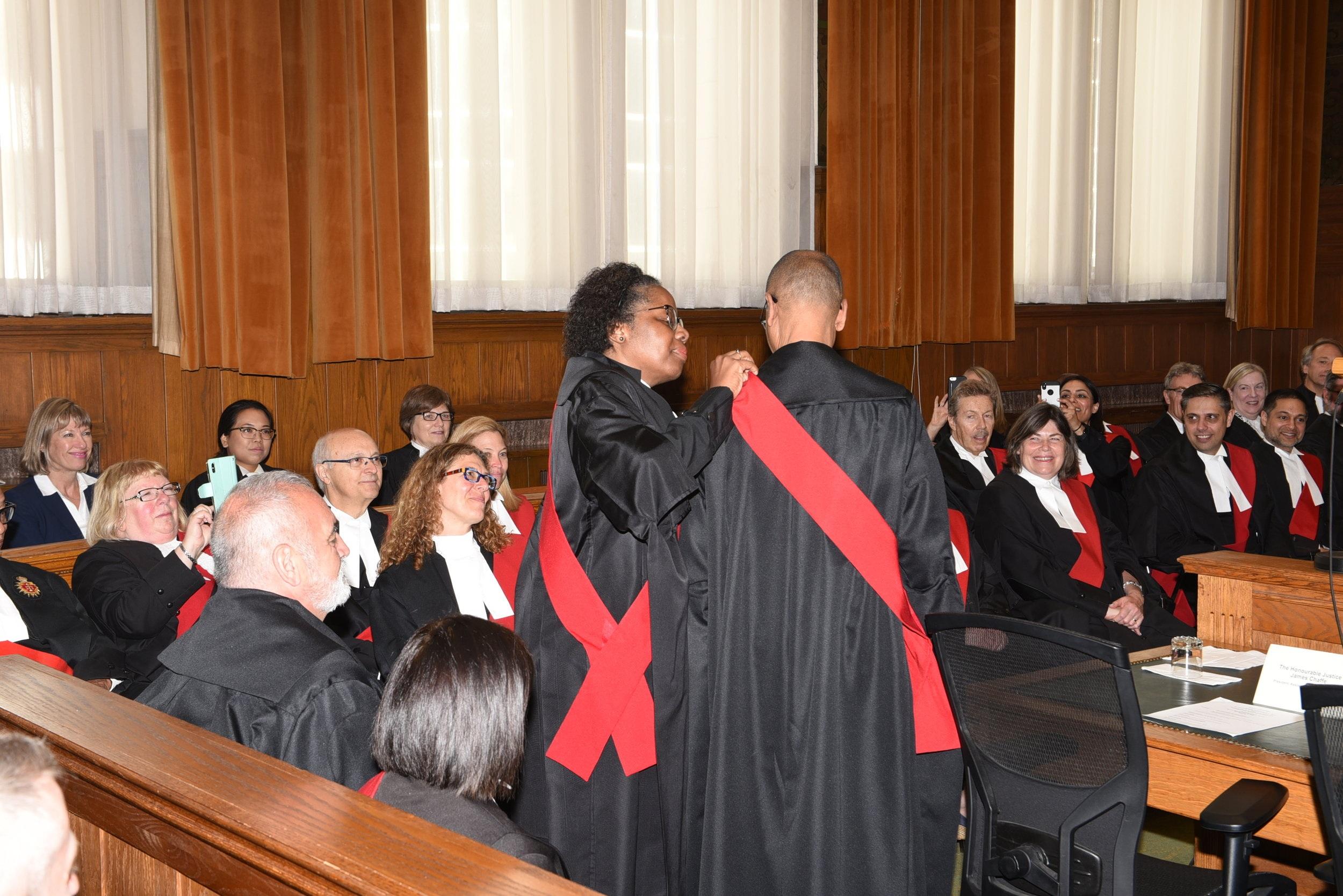 Justice Lori Montague puts on new judge David Maylor's judicial sash