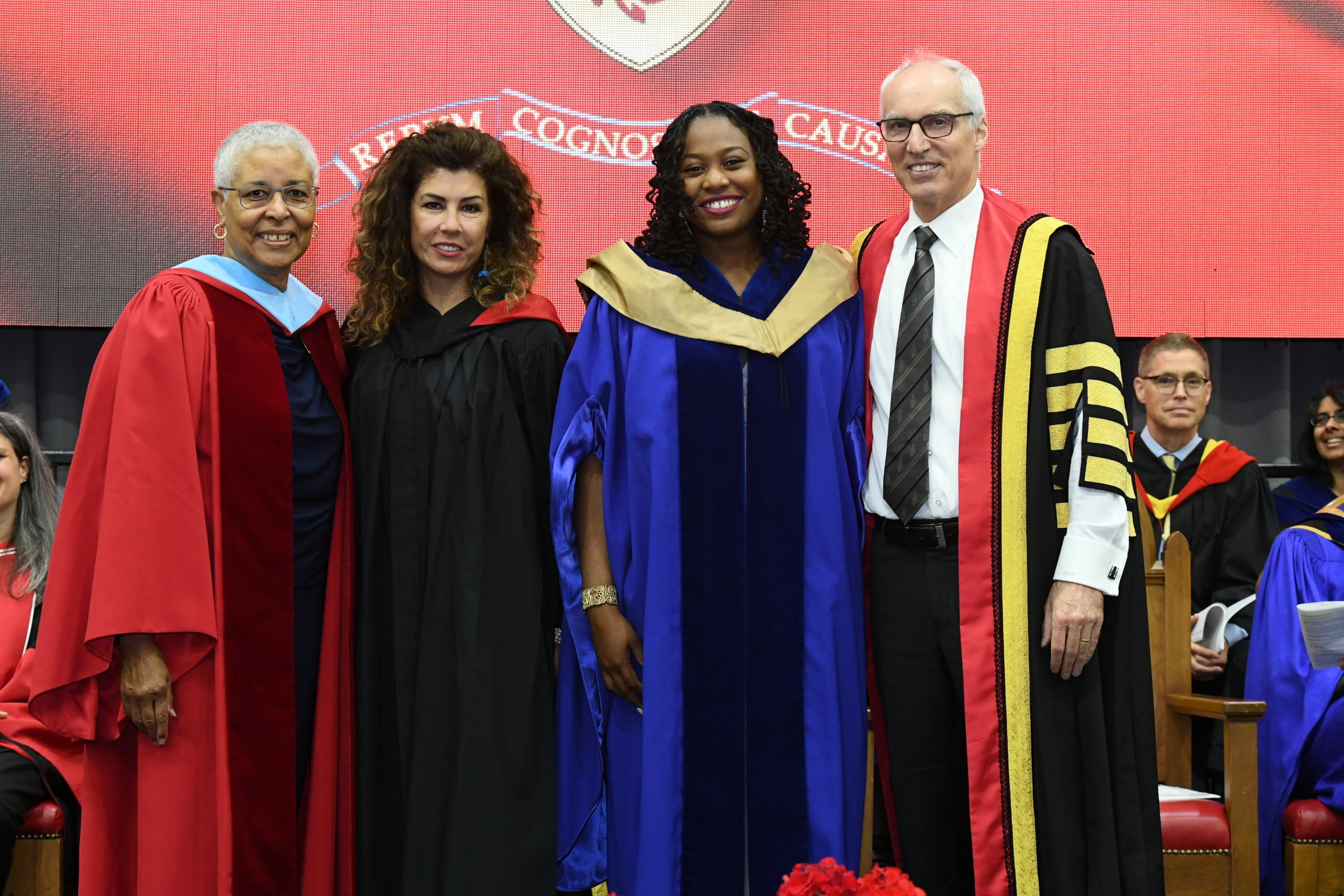 Dr. Rashelle Litchmore, proudly wearing a hood from this year's IMP graduation, with Mary Anne Chambers (l), doctoral advisor Safdar Saba and University of Guelph President & Vice-Chancellor Dr. Franco Vaccarino