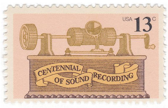 This quirky stamp uses ribbon as a background for the typeto separate it from the illustration and make it stand out against the image. (via Mystic Stamp Company)