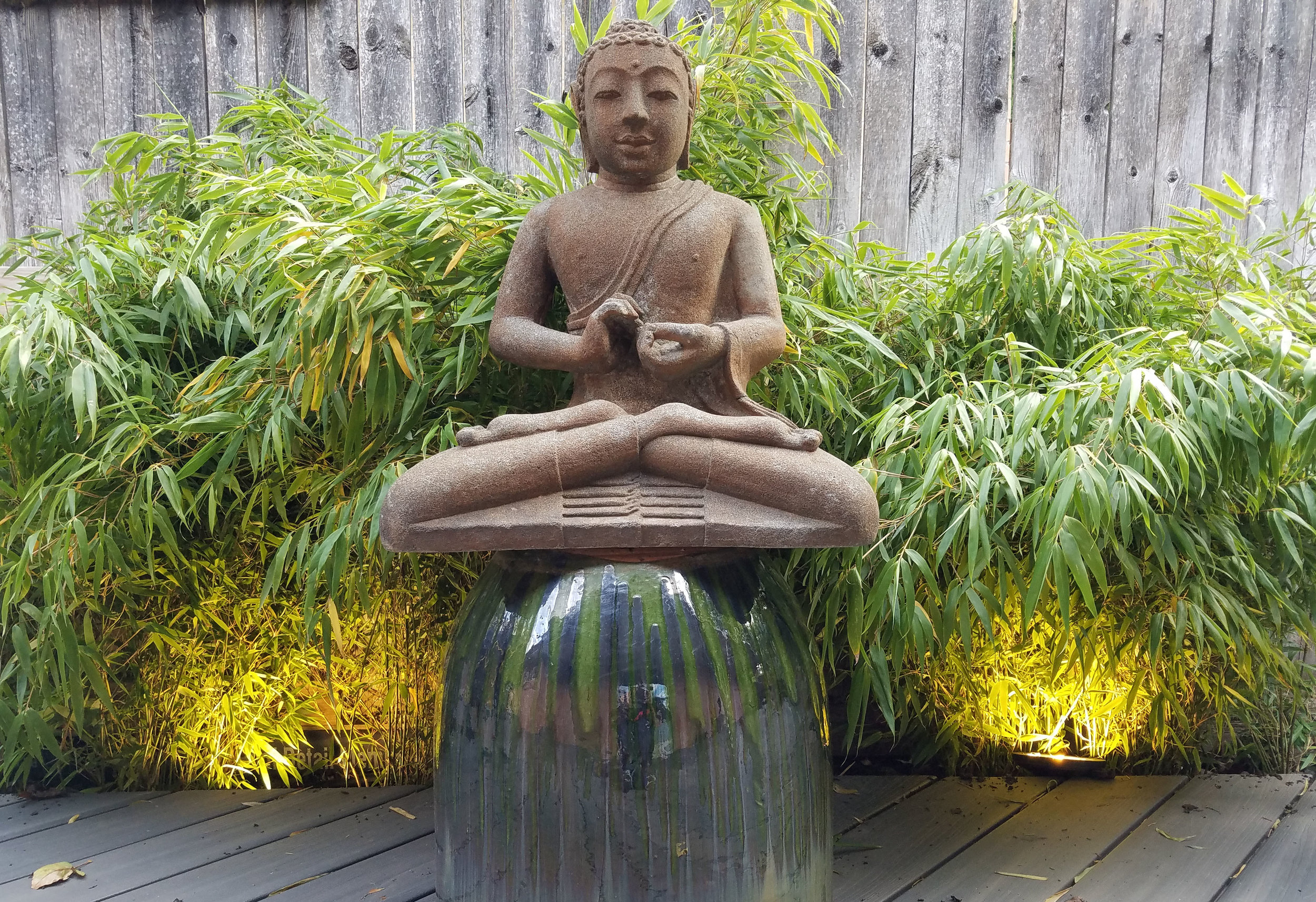 A BUDDHA STATUE PROVIDES A POINT OF FOCUS IN THE LOUNGE AREA