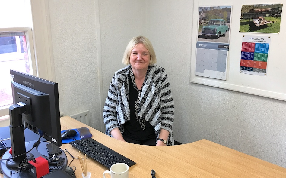 Ann Polding at her desk, inspiring everyone through out the business to continue learning
