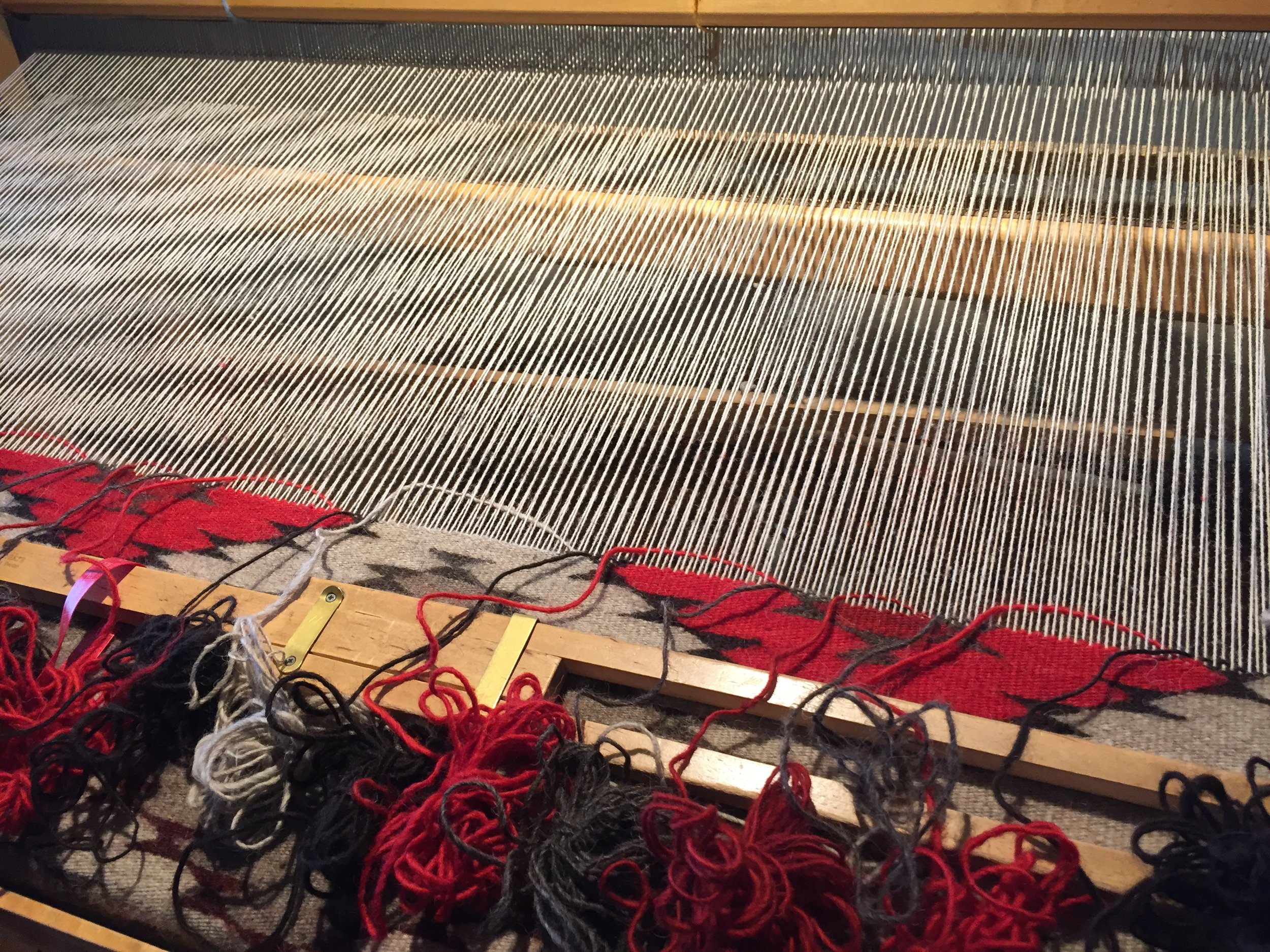"""Each of the yarn colors waiting to be added to the tapestry is organized into an individual hank, also referred to as a """"butterfly."""""""