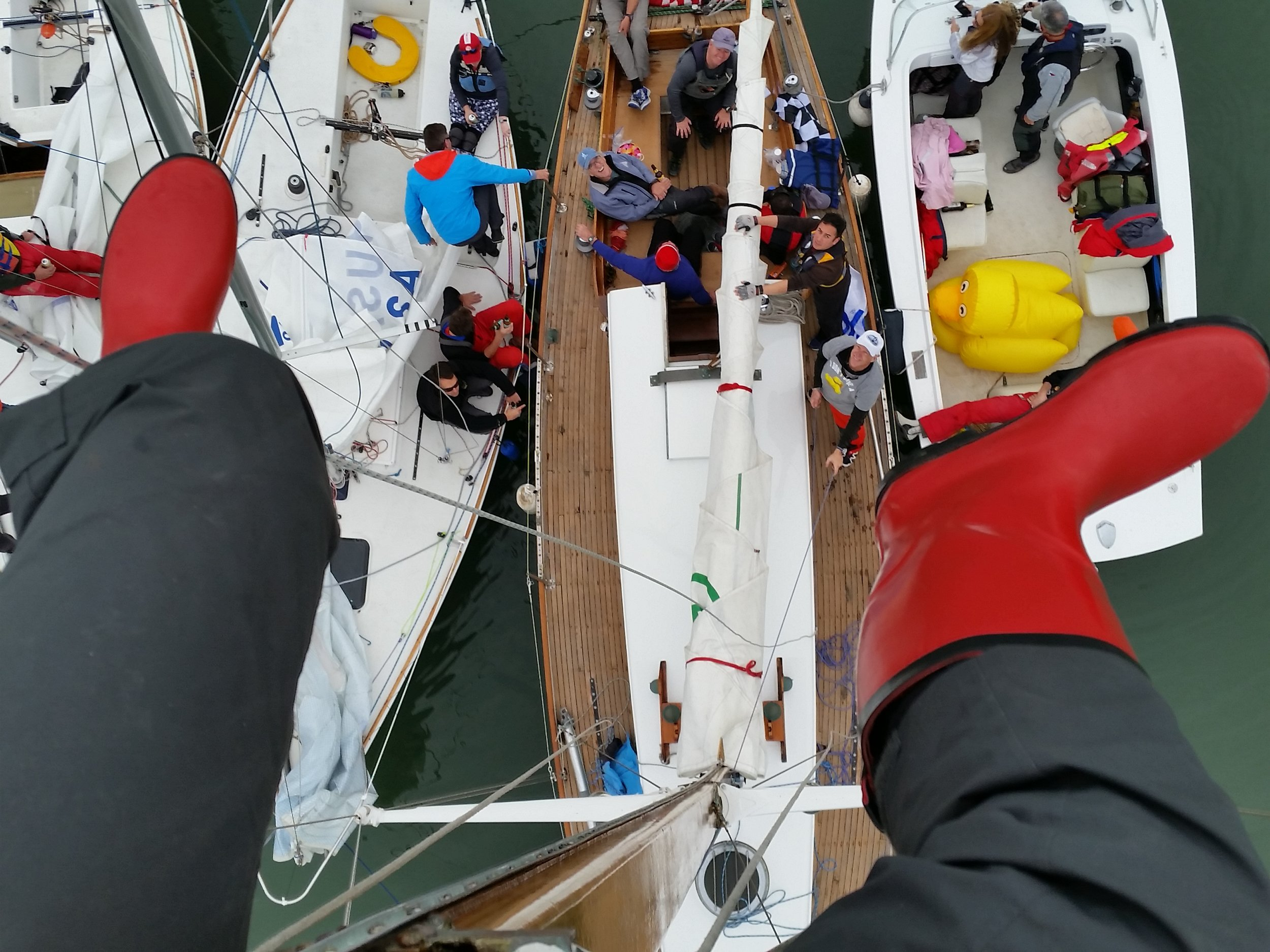 Every now and then things slow down long enough to scale a mast and grab new point of view. With silly red costume boots, up I go on the Clipper Farallon after he annual Crew You J/24 and small boats regatta.