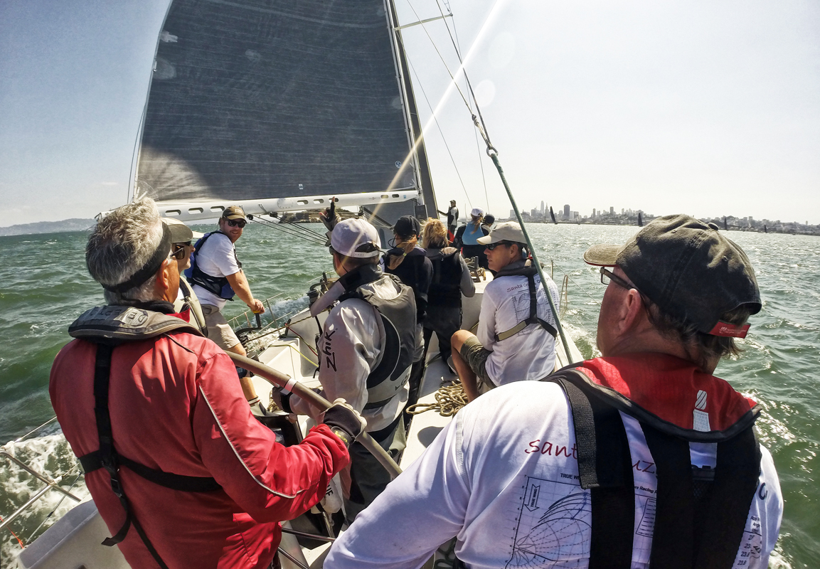 On the course early to check the tides aboard Santa Cruz 50  Deception  day two of Rolex Big Boat Series. A crew count of eleven is fine for days where under 20-knots prevail. Ahead is Alcatraz Island and to the right is the San Francisco city front.