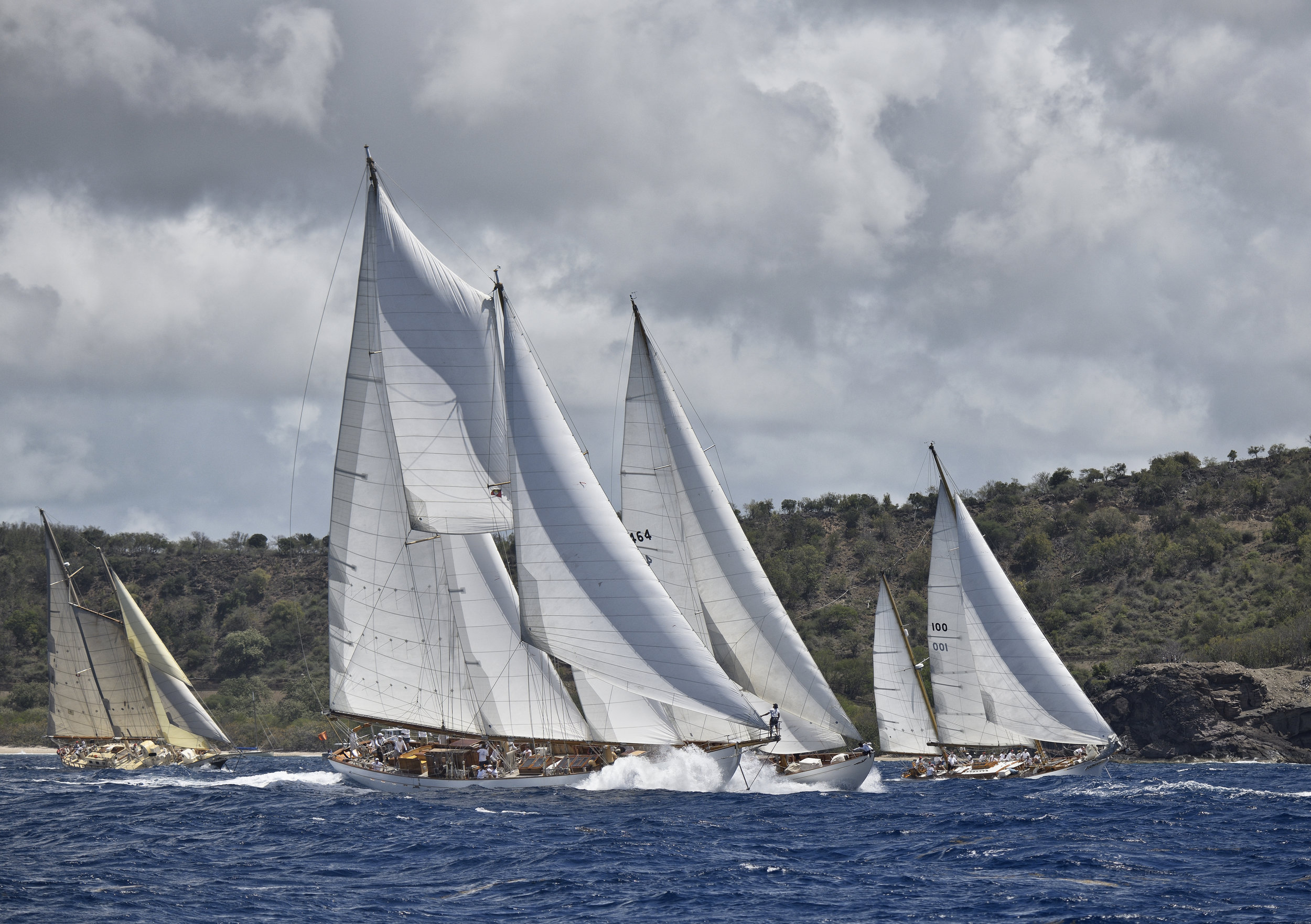 Long lens shot of the Antigua Classic Yacht Regatta, April 2018. In foreground is schooner  Eros  with bowman Wilson Willkom, aside is  Mariella  and  Ticonderoga  coming on strong.