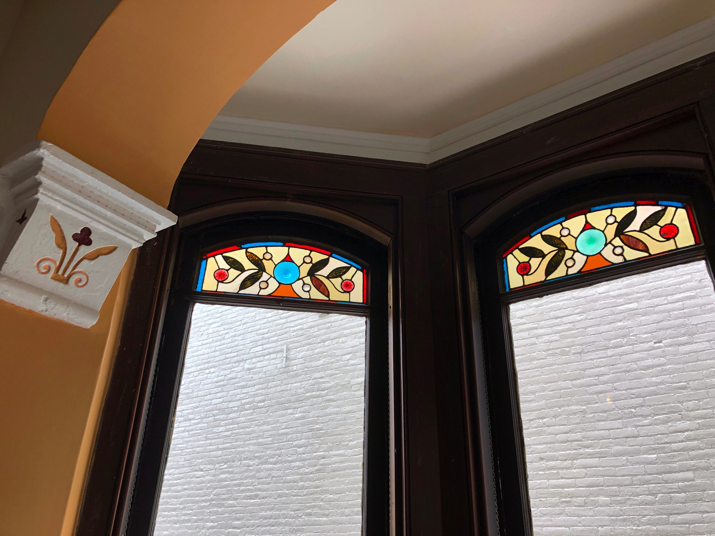 Stained glass panels top every window in our sitting area