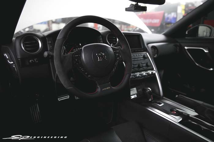 Wilson also started concentrating on interior details as well as the exterior of the vehicle. He opted for a few carbon pieces by CarbonTek, a Willall shift light and a MINE's steering wheel.