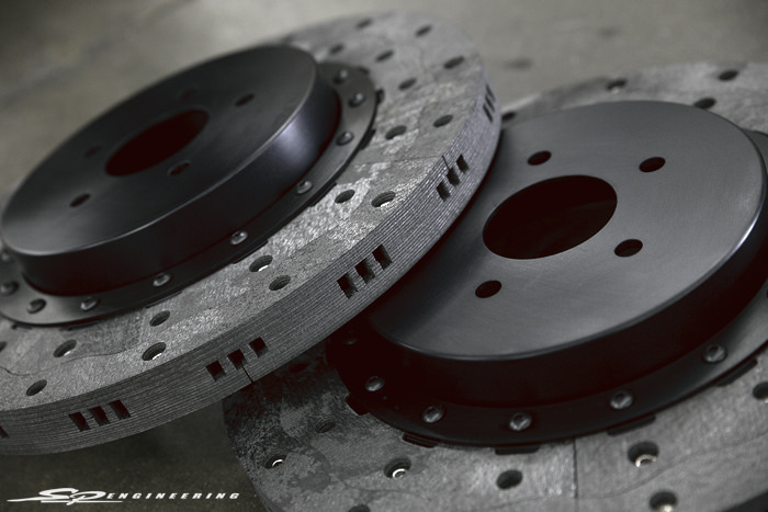""""""" However, it is precisely the fact that it takes months and not days to produce carbon-carbon that makes this material so special and superior to carbon-ceramic. There is a great video on Youtube called """"How It's Made, Carbon Composite Brakes"""" that illustrates how ceramic brakes are made. In short, carbon ceramic brakes are made using short chopped carbon fibers combined with powered resin with a thin ceramic coating. First the fibers and resin are put in a mold at high temperature to make the core rotor which is then coated with ceramic particles to make a hard brittle surface. There are three major problems with this process. First short chopped pieces of carbon are in no way as strong as the 3D woven sheets of carbon used by RPS. Using carbon-ceramic is like using a fiberglass chopper gun to lay up your boat versus hand laid sheets of material which is many times stronger. """"  – RPS Carbon Technology"""