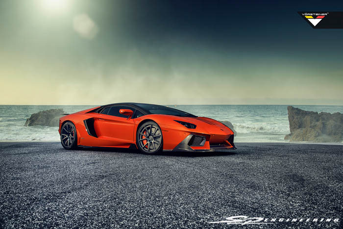 Exciting news we have received this week!  We are very excited to be the first to announce and introduce Vorsteiner's newest hot item for the Lamborghini Aventador – Zaragoza front fascia. They also released their Active-Aero Wing since it's introduction at SEMA last year.  The  Zaragoza front fascia will be made with pre-preg carbon fiber in a 2×2 gloss twill weave. Both pieces have been in the works for a long time now, and it is wonderful to see more love going towards the Aventador chassis. The ability to design the wing to work just as the OE is a testament of Vorsteiner's capabilities.  For those of you as excited as us about these new products,  SP Engineering  is now accepting pre-orders. As a distributor for Vorsteiner, we are excited to be the first to offer the  Zaragoza front fascia and Vorsteiner Active-Aero Wing for the Aventador.  All mentioned parts are made as pre-preg carbon fiber in a 2×2 gloss weave.    Zaragoza Front Fascia –$5,700   Zaragoza Front Fascia w/ V-Aero Kit –$20,500  Above w/ optional OE Carbon Fiber –$27,600   V-Aero Kit will include:   – Side Skirt Extensions – Rear Diffuser – Active-Aero Rear Wing Blade w/ Carbon Fiber Up-Rights (Uses factory strut functionality. One and only in the world to do so)   OE Exterior Parts include:   – Front Bumper Grill Frame (Right & Left) – Hood Vent Trim (Right & Left) – Side Air Scoop (Right & Left) – Rear Bumper Grills (Right & Left)