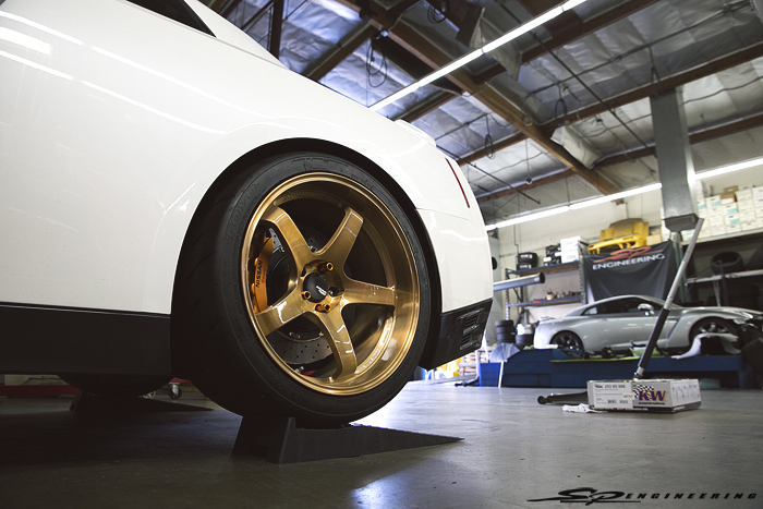 Don't mind the 3 lug nuts. The techs were setting ride height.