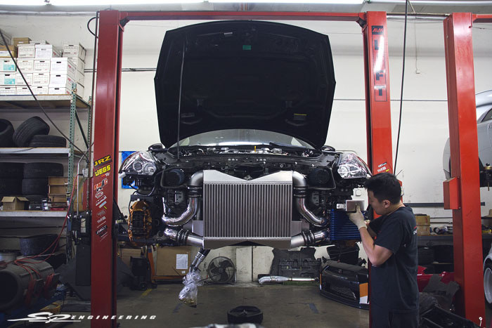 The intercooler system gets upgraded to our race intercooler with polished aluminum piping and Tial BOV's.