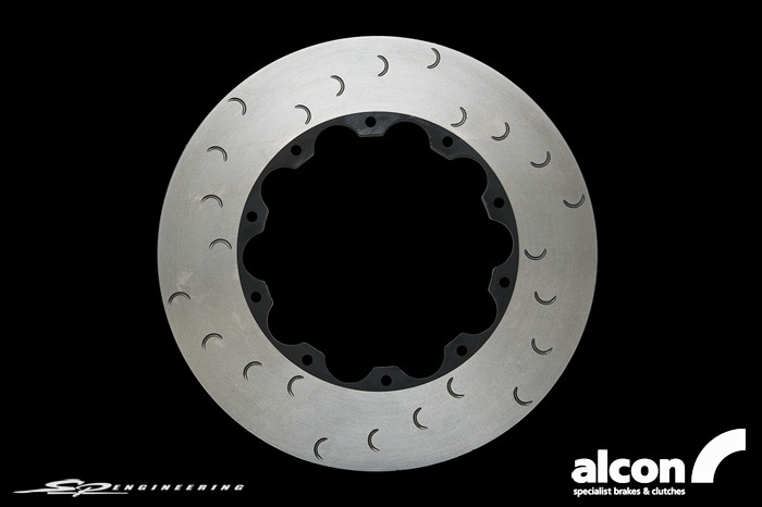 Alcon has developed a range of rotor options for the R35 GT-R that far surpass the performance and durability of the stock brakes, at an affordable price. These rotor kits offer a wide range of options that work seamlessly with the OE calipers.  These Alcon rotors are made from the same unique iron alloy and undergo the same manufacturing processes as all Alcon race rotors, providing superior dimensional stability and resistance to thermal stress.  Alcon's crescent grooves continuously refresh the brake pad surface and prevent gas build up from the pads. Exceptional levels of initial bite and feel are achieved without the inherent cracking issues associated with drilled rotors.
