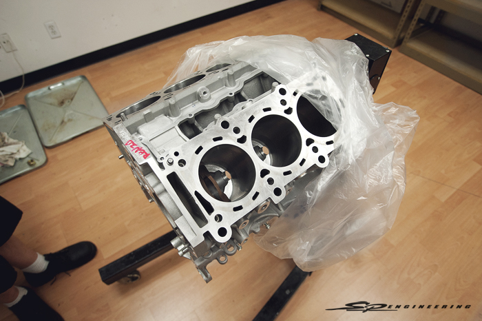 Sorry for taking apart a brand new engine,Izumi-San, but the customer wanted more power. Also known as a Takumi, Izumi Shioya is one of the four sole engine assemblers at Nissan's expansive engine factory in Yokohama, Japan.