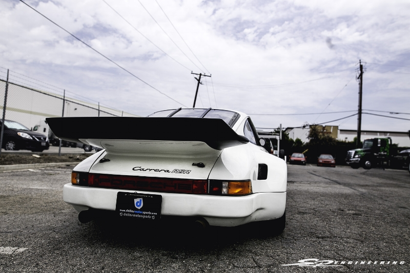 I believe this rear spoiler is larger than your average whale's tail.