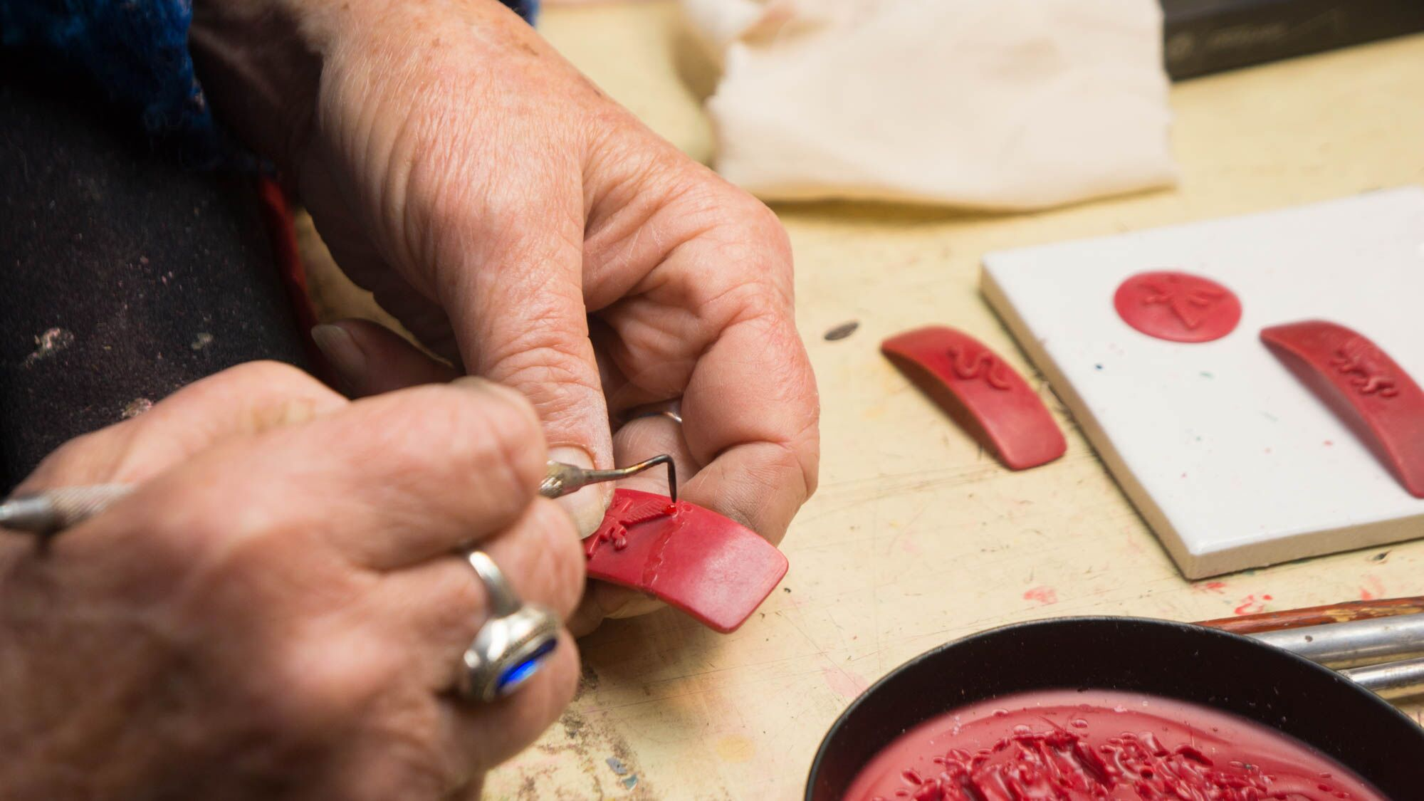 Claudette hand-carving one of our eagle bands in wax. 2016