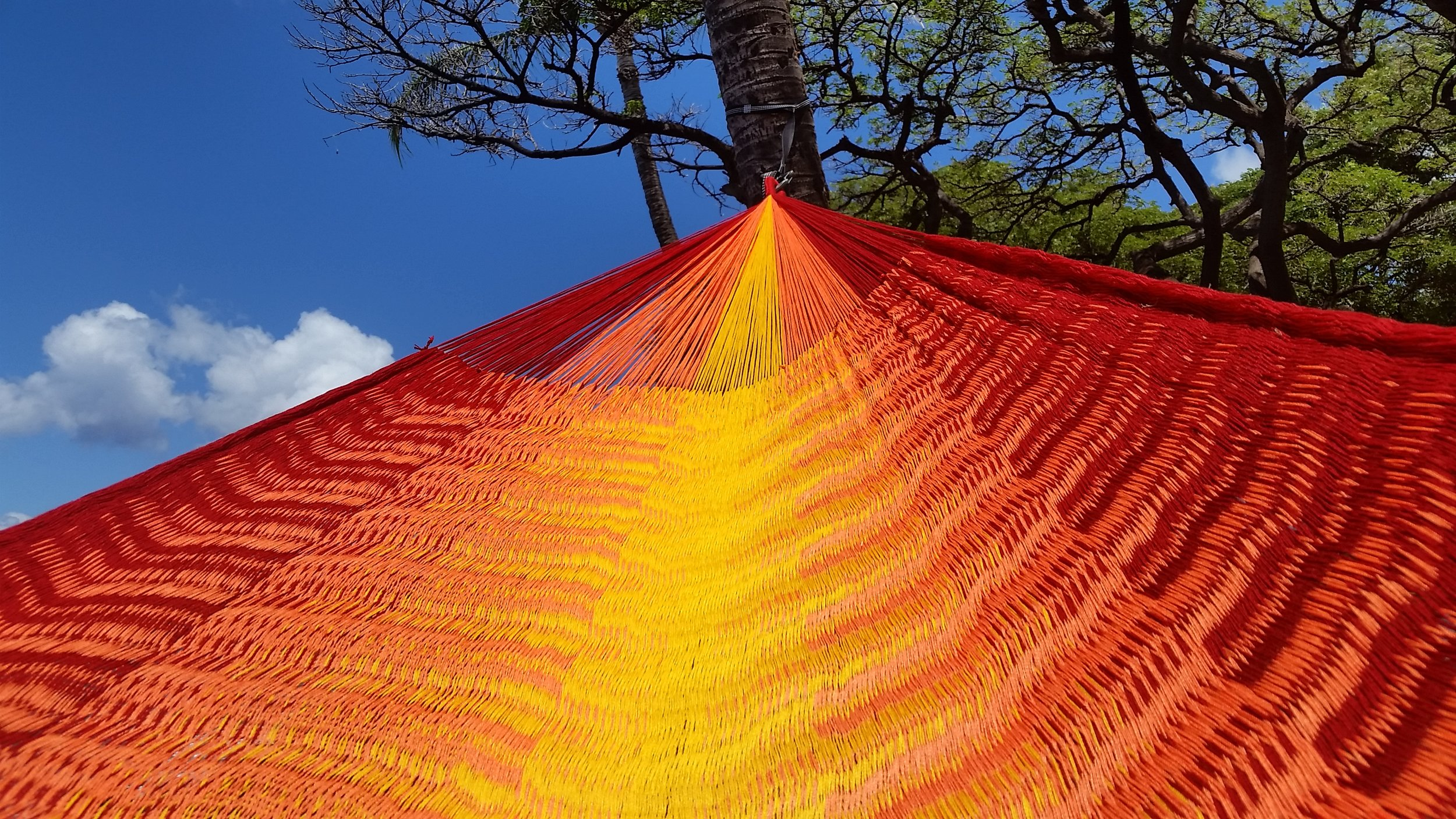 """(Contact us for colors available as they change daily)   Referred to as the """"V-Weave"""", this hammock is considered to be the Rolls Royce of hammocks. Extra large and luxurious. The V-Weaveing technique causes a subtle color change when the hammock is in motion. The densely woven technique results in a hammock that is incomparable in both comfort and beauty. It takes a specialist weaver up to 3 weeks to produce just one of these hammocks. From 3km of yarn and over 150,000 loops, woven with ultra soft triple acrylic yarn. This hammock is the worlds finest. We carry a very limited number of these a year.We label each hammocks after our favorite surf breaks.Kicking back in one of these hammocks while enjoying an afternoon admiring the scene, is sure to make an impression."""