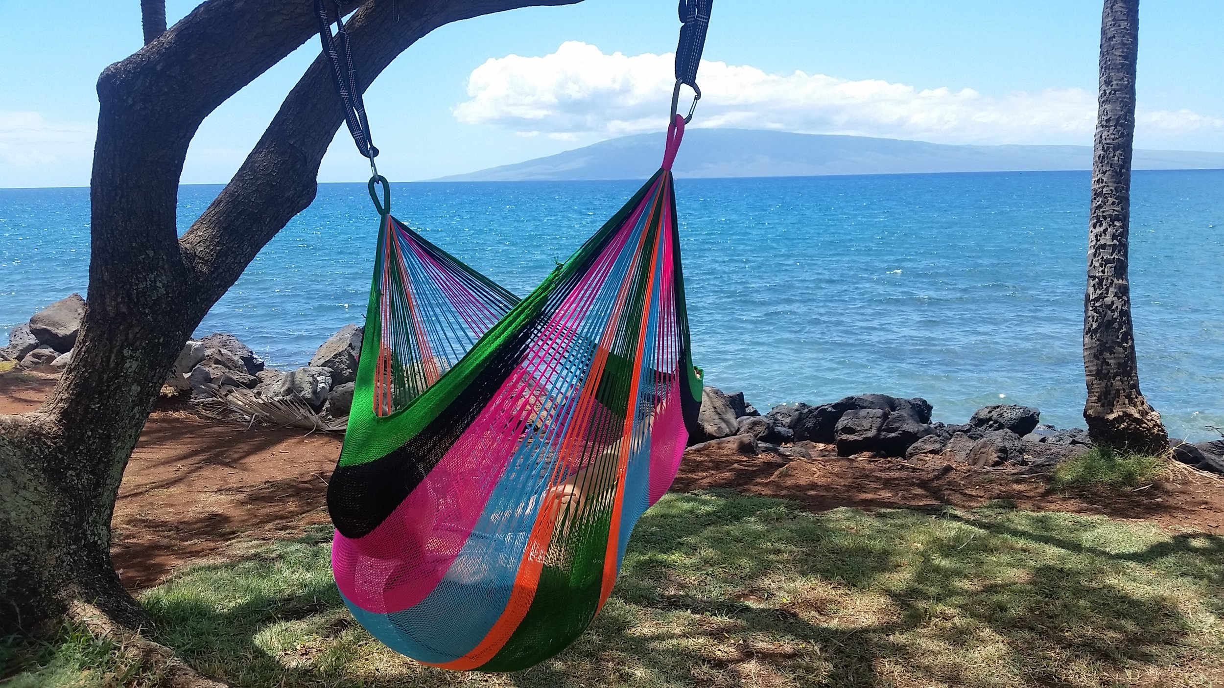 """(Contact us for colors available as they change daily)   Referred to as the """"Sitting Hammock""""in size, this hammock is extra comfy for 1 person with a weight support of 300+ lb.Sit down or extend out into a full laying position. Ultra soft,hand woven triple acrylic hammocks can be left outdoors without worry of them losing color or shape.The Thai Sitting Hammock weaving process takes up to 2 weeks to create. This weatherproof hammock is ideal for any outdoor area, great for the beach or lounging by the pool. Luxuriously soft and comfortable. Come rain or shine, you can leave it outdoors and the colors stay bright for many years. The Thai Sitting hammock is available in many unique designs and colors not seen in any other hammocks in the world. We label them after our favorite beach spots on Maui, a perfect place to enjoy them."""