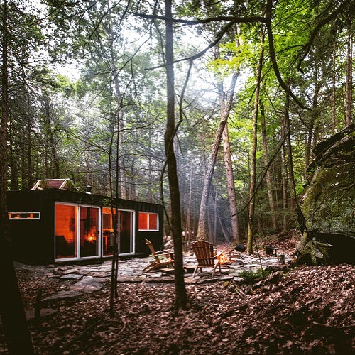 When I'm in the #woods I'd rather be outdoors, but our #container #cabin guarantees dry, comfortable shelter year round. #ecofriendly #offgrid #cabinporn #saugerties #cabinlife #dwell