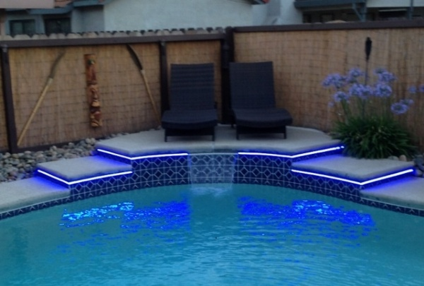 LED lighting around a pool can be soothing and whimsical.