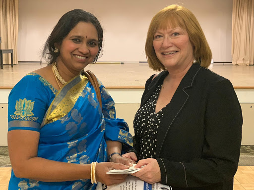 Guru. Smt. Preetha Sheshadri of the Kalaniketan School of Indian Music and Dance presents a generous donation to Stephanie Demos, HomeFirst's Chief Development and Communications Officer