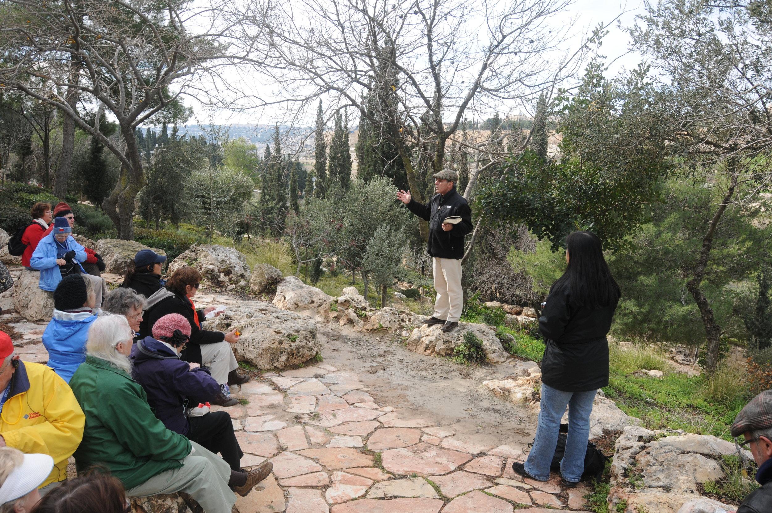 Dr. Creasy teaches in the Garden of Gethsemane.