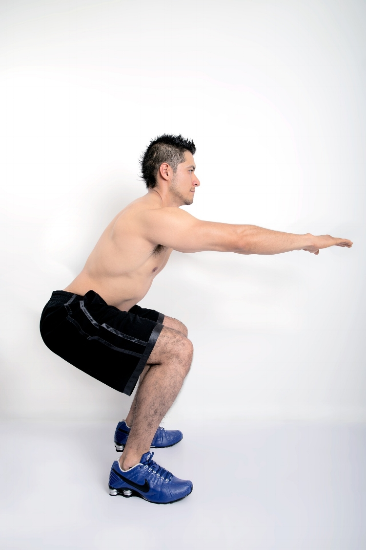 By using lighter versions of the exercises that will feature in your main session, your warm-up becomes more specific and time-efficient. The Body-Weight Squat with gradually increasing range of motion (ROM) could form part of a 'warm-up' circuit prior to a more intense conditioning circuit.