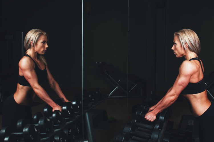 The best way to 'tone-up' is to drop the ankle weights and leg lifts, and work with some decent resistance in a progressive strength programme.