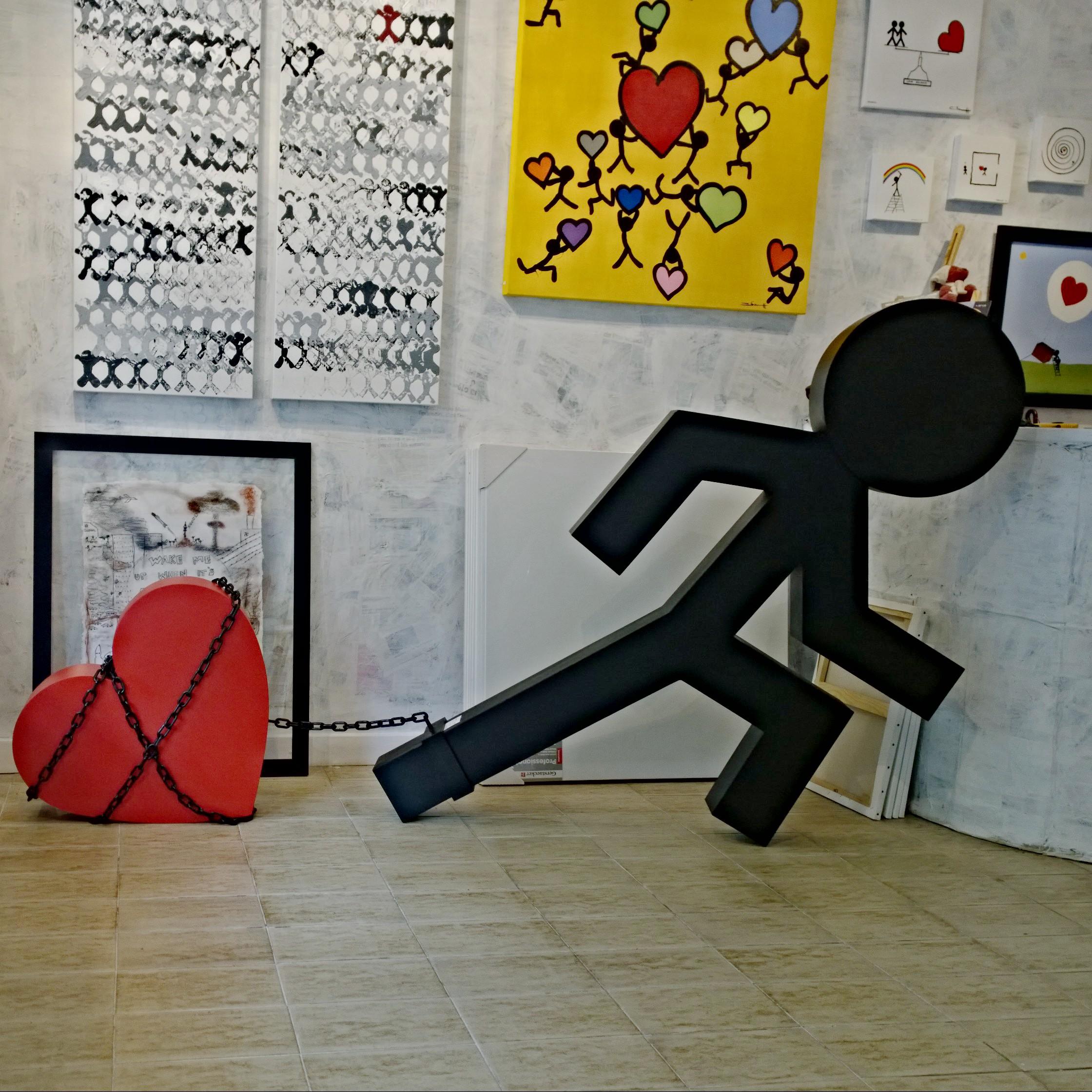 Chained to love (enchainé à l'amour)   Sculpture en metal réalisé par Remy DIAZ selon l'idée de Oliver HENGGELER