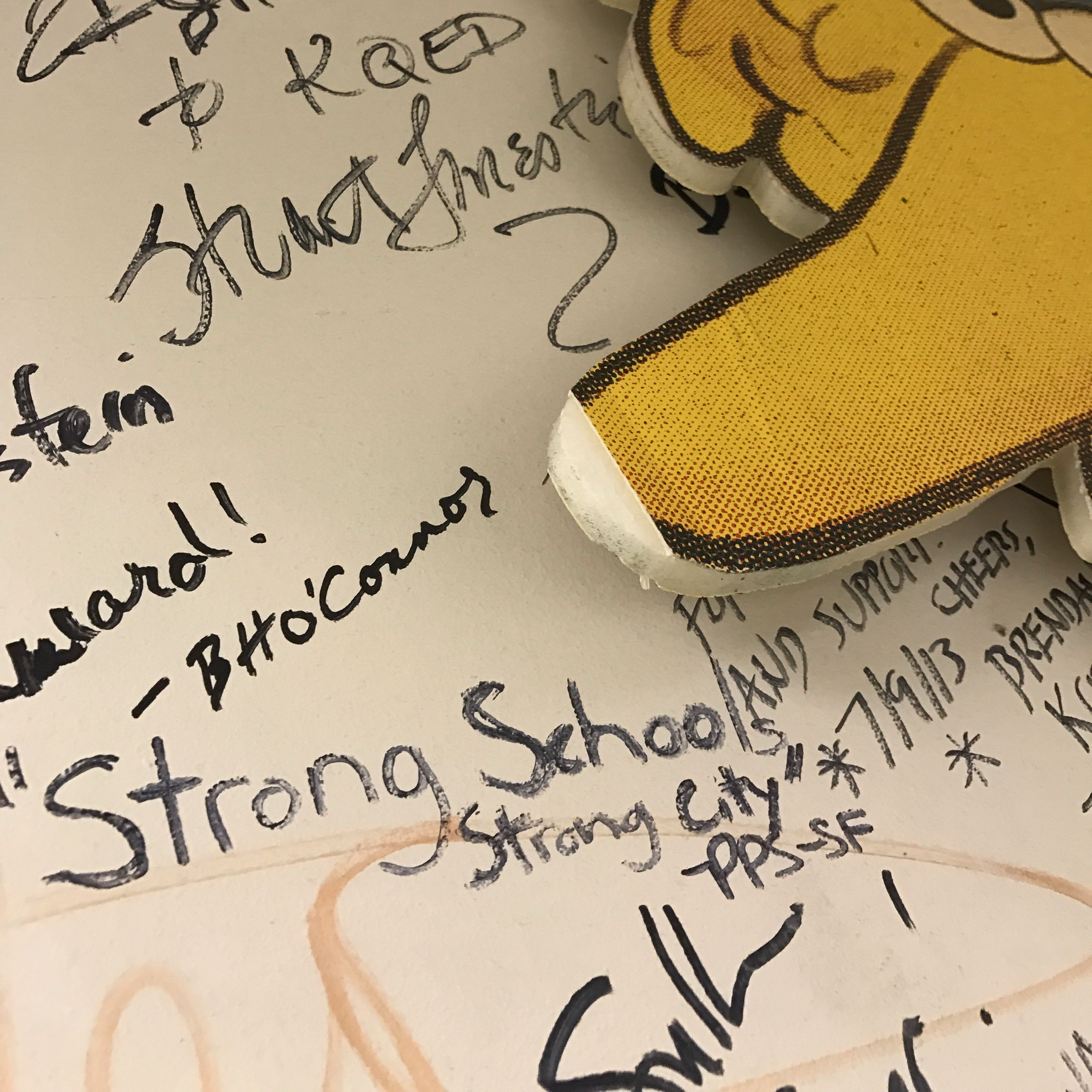 """Miranda Martin signed the famous KQED Forum wall with """"Strong Schools. Strong City,"""" in honor of PPS-SF."""