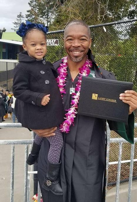 Greg with niece on his graduation day achieving his goal of higher education!
