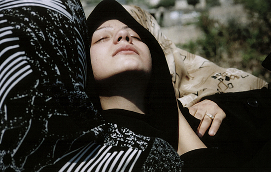 Young widow at her husband's grave. Lebanon, 2006