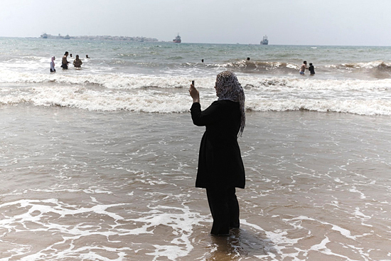 Iraqi refugee, a young widow whose husband was killed, visits the sea for the first time since her arrival to Syria several months ago. Tartus, Syria, 2008