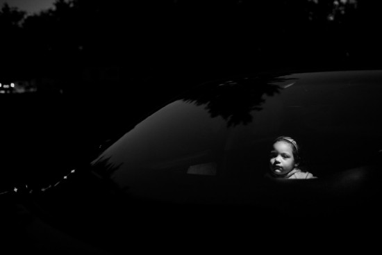Destiny, 4, poses in her stepfather's car in Mansfield, Ohio. Destiny's biological father was a drug dealer and was recently released from prison. She has never seen him. Her mother, Patricia, went through substance abuse treatment and graduated in the Spring of 2009. She relapsed again in June of 2009. Destiny lives with her grandparents in Mansfield, Ohio.