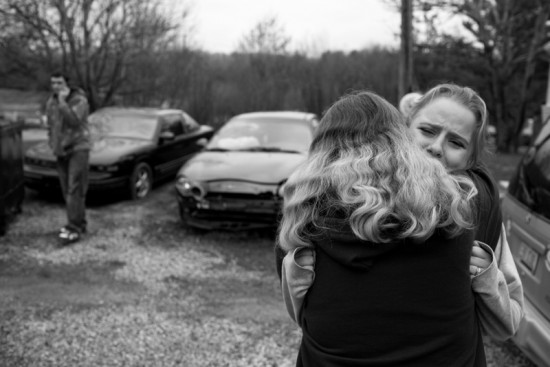 """Stephanie, 19, cries on her mother's shoulder after graduating from the Rural Women's Recovery Program on Tuesday, April 14, 2009, in Athens, Ohio. Her probation officer ordered her to attend the substance abuse program due to her drug charges. She lost custody of both of her children. She started using drugs when she was with her ex-boyfriend, Carroll, the father of her daughter. """"He beat me all the time, choked me, shouted at me, put a knife to my throat. I felt like shit. That's why I used – so that I could hide my feelings. I started out with lower doses of Vicodin and Percocet, then I went to Oxycontin and heroin."""""""